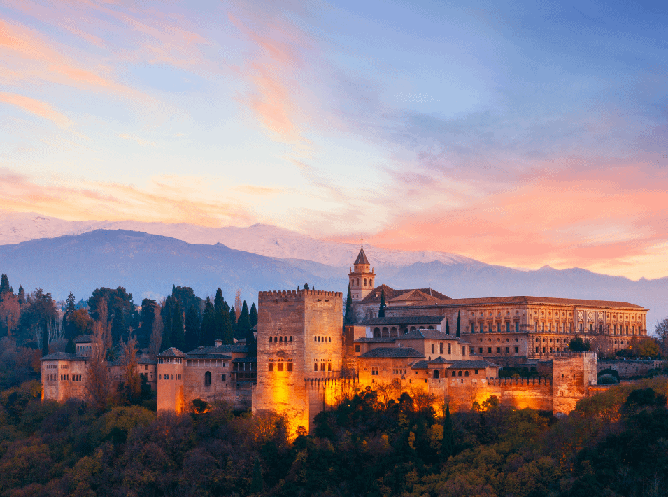 alhambra palace lit up in the evening